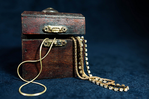 Gold chains in tiny wooden chest